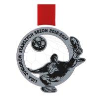Medal z pleksy i laminatu z grawerem, zawieszony na czerwonej wstążce